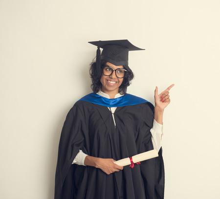 pakistani females: indian female student graduating in vintage tone Stock Photo