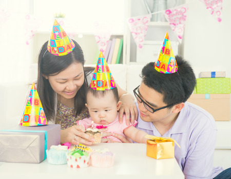 festoon: asian parent with baby during birthday
