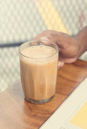 tarik: asian male having teh tarik during a break
