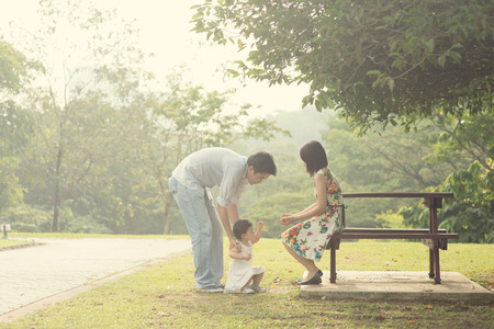 asian family playing and enjoying quality time outdoor , vintage tone Stock Photo