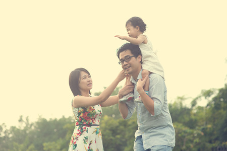 quality time: asian family playing and enjoying quality time outdoor , vintage tone Stock Photo