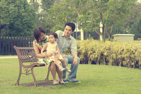 asian family outdoor: asian family playing and enjoying quality time outdoor , vintage tone Stock Photo