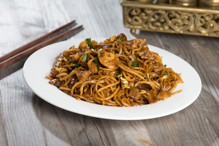 Fried Penang Char Kuey Teow which is a popular noodle dish in Malaysia, Indonesia, Brunei and Singapore