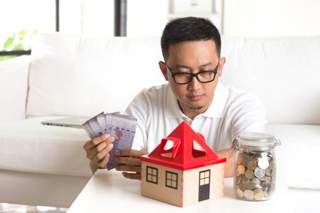 asian casual male and house loan Archivio Fotografico