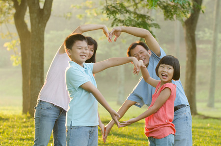 family exercise: Asian Family Enjoying Walk In Summer Countryside