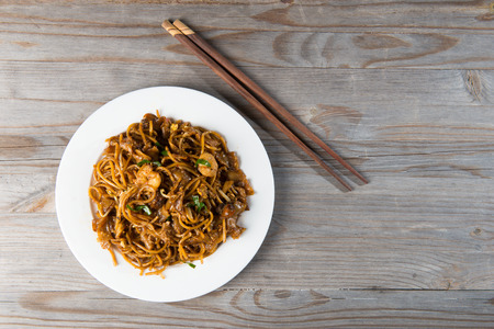 asian noodles: Fried Penang Char Kuey Teow top down view which is a popular noodle dish in Malaysia, Indonesia, Brunei and Singapore
