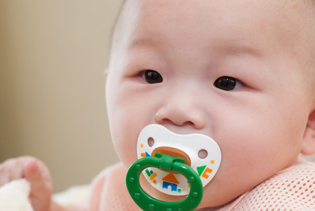 asian baby with a pacifier