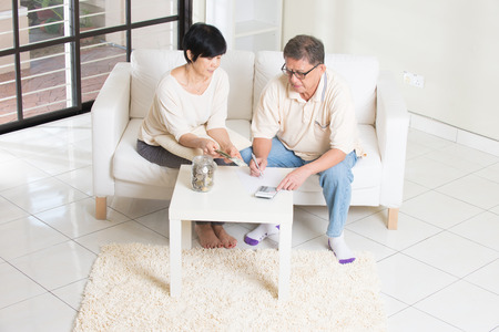 old asian: asian senior couple calculating finance at their home