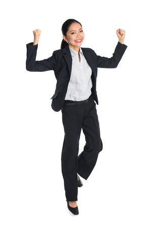 body image: Successful young business woman happy for her success. Isolated full body image on white background.