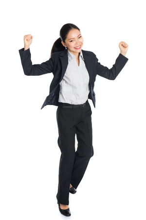 business asia: Successful young business woman happy for her success. Isolated full body image on white background.