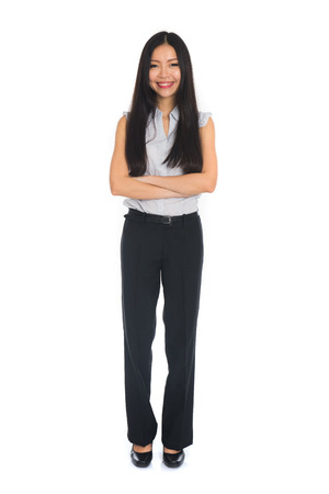 asia business: Business woman standing in full length isolated on white background. Beautiful mixed race Chinese female mode in suit.