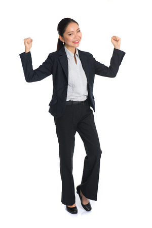 businesswoman suit: Successful young business woman happy for her success.
