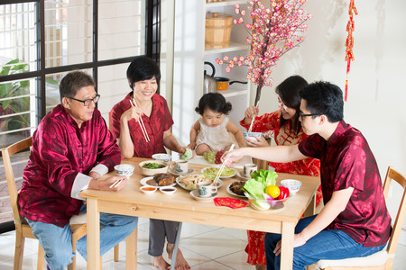 chinese new year food: Chinese new year reunion dinner, part of Chinese culture to gather during eve Stock Photo