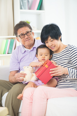 grand sons: asian grand parents with grand daugther celebrating christmas