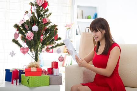 christmas tree presents: christmas asian girl Stock Photo