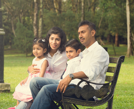 indian family enjoying quality time at outdoor park Banco de Imagens