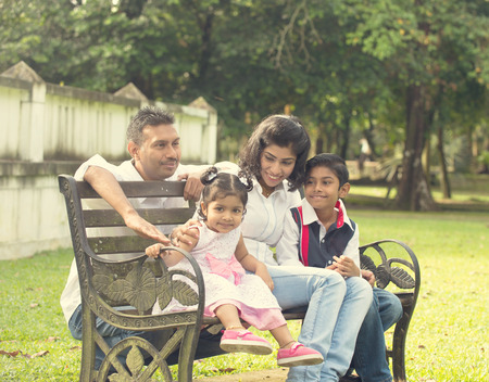quality time: indian family enjoying quality time at outdoor park Stock Photo