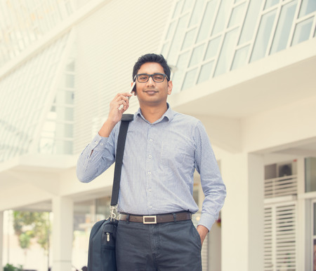 businessman suit: indian male over on a phone conversation