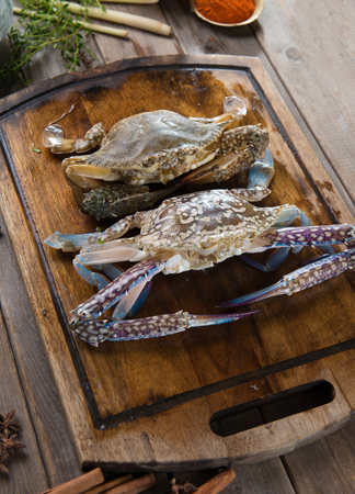 decapod: raw crabs with spices for cooking preparation