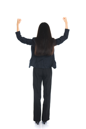 hair back: Asian business woman from the back - looking at something isolated over white background Stock Photo