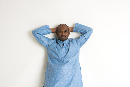 kurta: Traditional Indian man relaxed Stock Photo