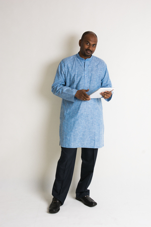 salwar: traditional indian male with tablet and plenty of copyspace