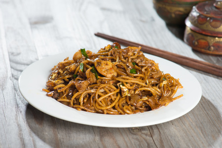 char: Fried Penang Char Kuey Teow which is a popular noodle dish in Malaysia, Indonesia, Brunei and Singapore