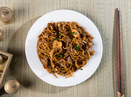 top down: Fried Penang Char Kuey Teow top down view which is a popular noodle dish in Malaysia, Indonesia, Brunei and Singapore