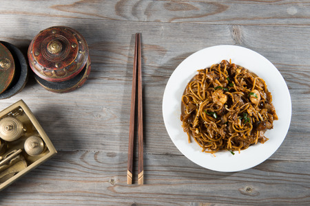 Fried Penang Char Kuey Teow top down view which is a popular noodle dish in Malaysia, Indonesia, Brunei and Singapore