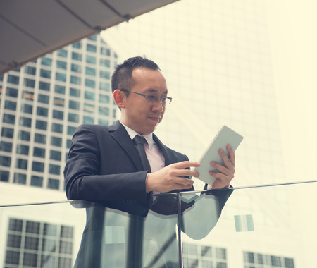 touch pad: Asian Business man using a touch pad PC