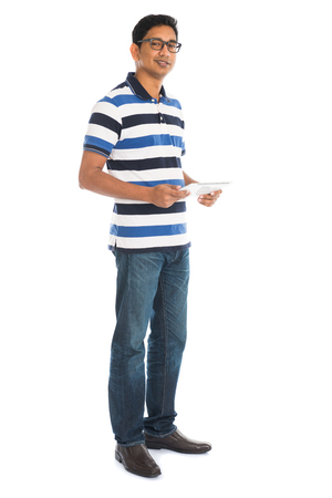 touch down: Happy young man using digital tablet against white background.
