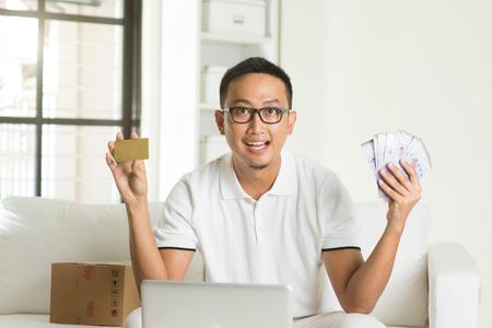 cash card: asian male enjoying cash back credit card Stock Photo