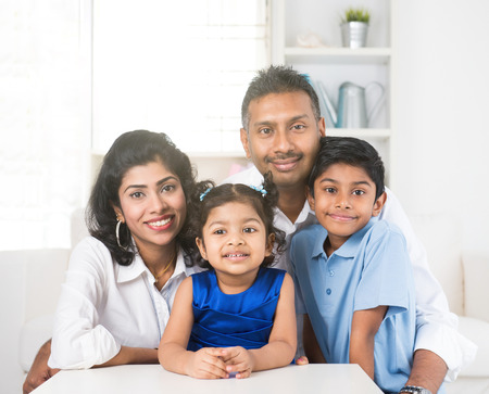 indian happy family: portrait photo of happy indian family Stock Photo