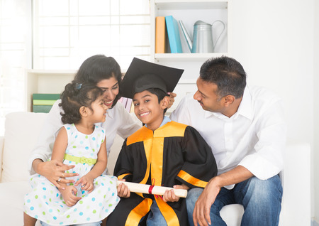 Happy indian family graduation, education concept photo