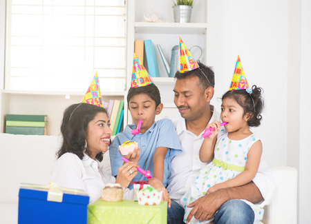 party hat: indian family birthday celebration with son and daughter