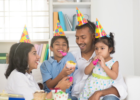 south asian: indian family birthday celebration with son and daughter