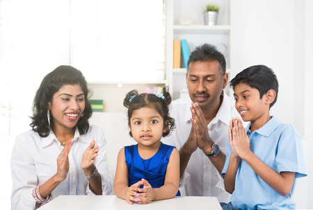 family isolated: portrait photo of happy indian family Stock Photo