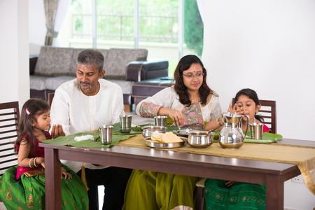 indian family having a meal Stock Photo