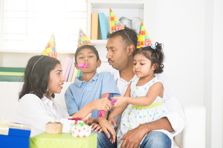 south indian: indian family birthday celebration with son and daughter