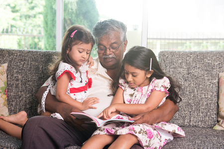 three story: indian grandfather learning with his granddaughters Stock Photo