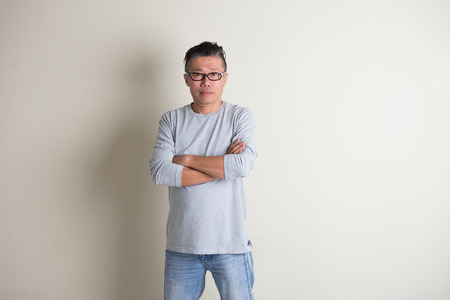 age old: asian senior male in casual ,crossed arm Stock Photo