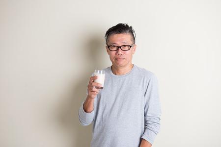 protien: asian senior drinking milk Stock Photo