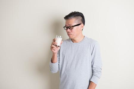 asia people: asian senior drinking milk Stock Photo