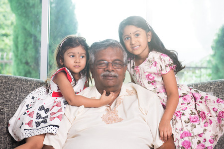old man happy: portrait of indian granparent and his grandchildren