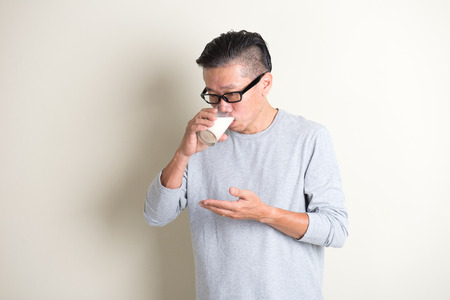 1 mature man: asian senior drinking milk Stock Photo