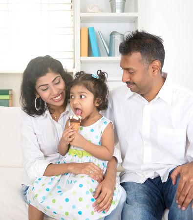 ice cream woman: indian family enjoying ice cream