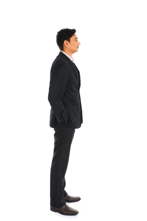 indian business man with coat standing, side view
