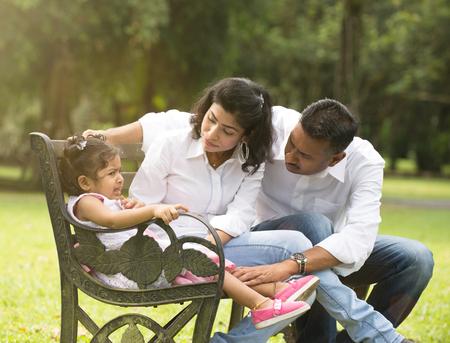 tantrum: indian parent dealing with daughter with tantrum