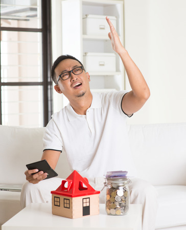 asia people: asian man stress on high property price and debts