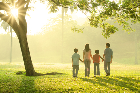 family on grass: asian family walking outdoor in the morning Stock Photo